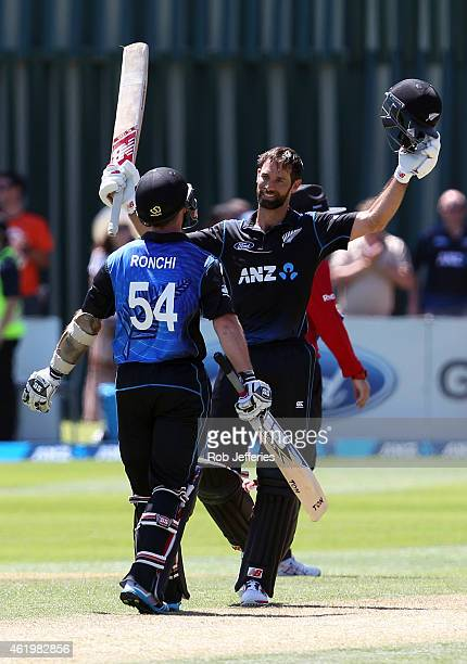 Grant Elliott of New Zealand is congratulated by Luke Ronchi after scoring 100 runs during the One Day International match between New Zealand and...