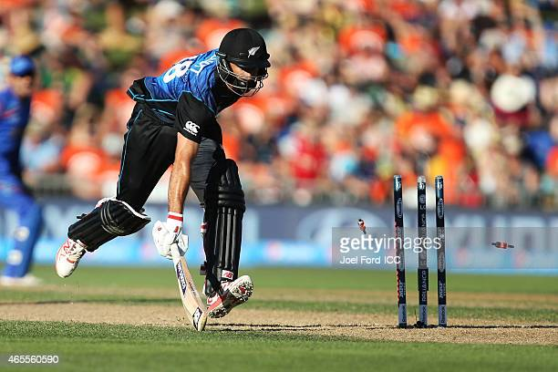 Grant Elliott of the Black Caps is run out during the 2015 ICC Cricket World Cup match between New Zealand and Afghanistan at McLean Park on March 8...