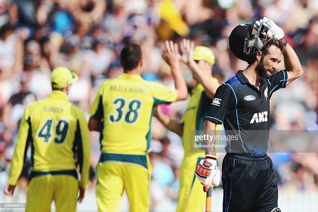 Grant Elliott of the Black Caps takes a break as Corey Anderson of the Black Caps Ish Sodhi of the Black Caps dismissed during the 3rd One Day International cricket match between the New Zealand Black Caps and Australia at Seddon Park on February 8, 2016 in Hamilton, New Zealand.