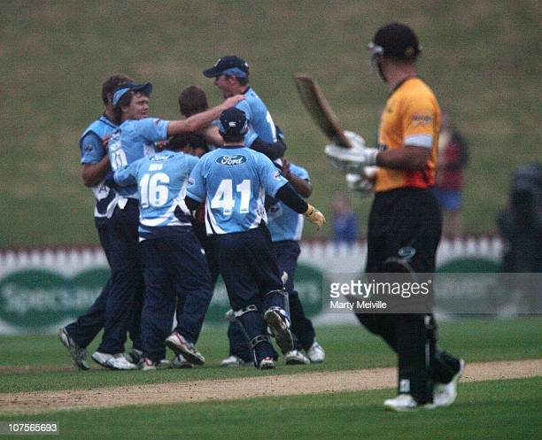 Grant Elliott of the Firebirds walks from the field after defeat during the HRV Twenty20 match between the Wellington Firebirds and Auckland Aces at...