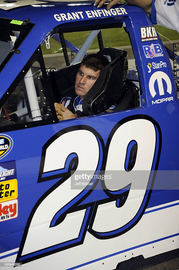Grant Enfinger, driver of the #29 Reese Towpower RAM, sits in his car during qualifying for the NASCAR Camping World Truck Series Smith's 350 race at Las Vegas Motor Speedway on September 28, 2012 in Las Vegas, Nevada.