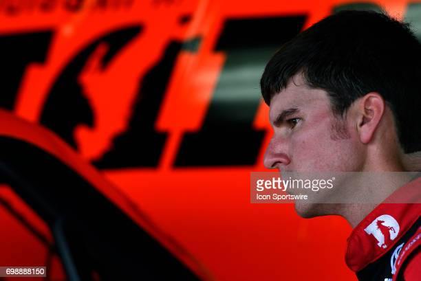 Grant Enfinger Toyota Tundra looks on as his crew works on preparing his truck for the NASCAR Camping World Truck Series Drivin' for Linemen 200 on...