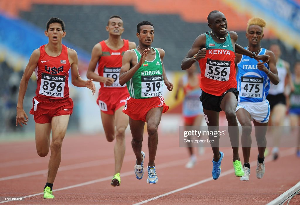 Grant Fisher of USA (896), Adisneh Amibelu of Ethiopia (319) and Titus Kipruto Kibiego of Kenya (556) push themselves on the home straight in the Boys 1500m Round 1 race during Day 2 of the IAAF World Youth Championships at the RSC Olimpiyskiy Stadium on July 11, 2013 in Donetsk, Ukraine.