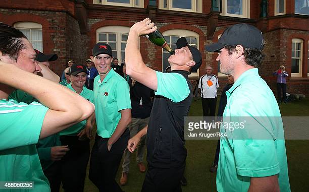 Grant Forrest of Great Britain Ireland and his teammates celebrate following the Sunday Singles on Day Two of the 2015 Walker Cup at Royal Lytham St...