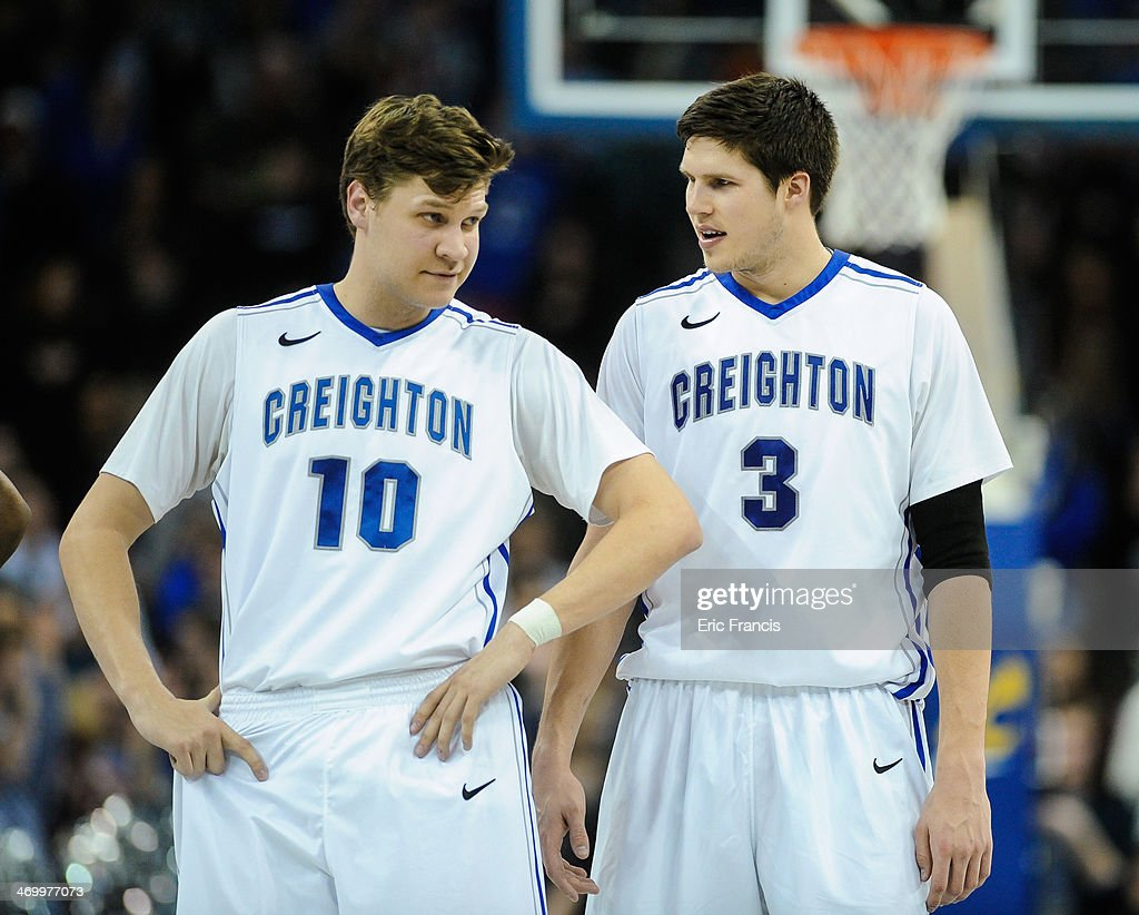 Grant Gibbs #10 and Doug McDermott #3 of the Creighton Bluejays chat during a timeout during their game against the DePaul Blue Demons at CenturyLink Center on February 7, 2014 in Omaha, Nebraska.