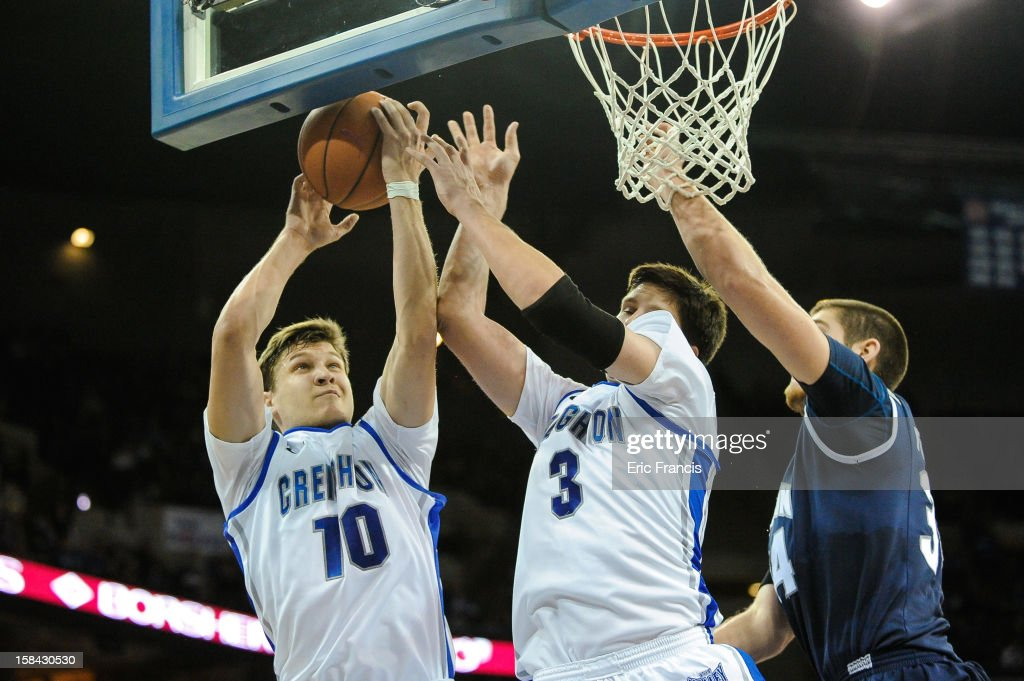 Grant Gibbs #10 and Doug McDermott #3 of the Creighton Bluejays secure a rebound from Pat Forsythe #34 of the Akron Zips during their game at the CenturyLink Center on December 9, 2012 in Omaha, Nebraska. Creighton defeated Akron 77-61.