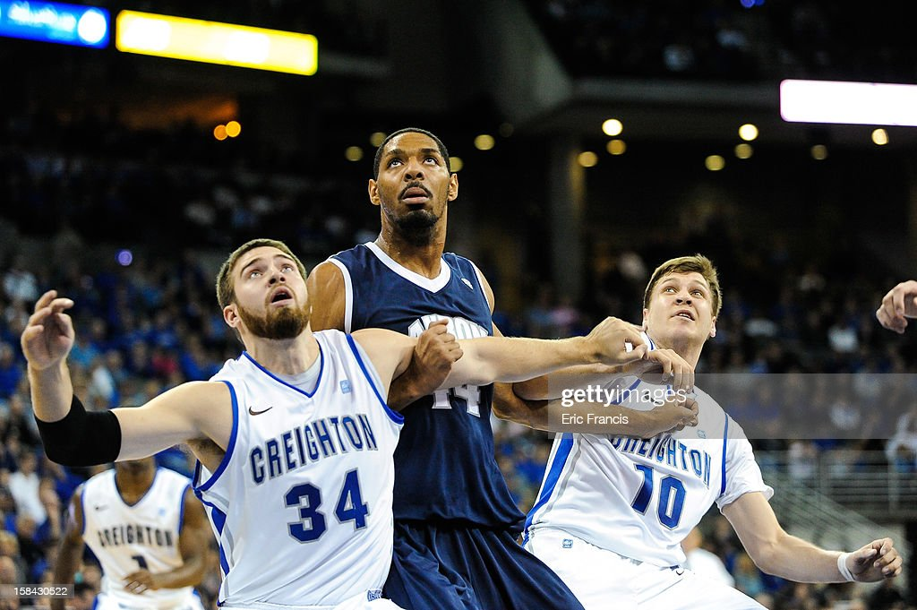 Grant Gibbs #10 and Ethan Wragge #34 of the Creighton Bluejays contain Zeke Marshall #44 of the Akron Zips during their game at the CenturyLink Center on December 9, 2012 in Omaha, Nebraska. Creighton defeated Akron 77-61.