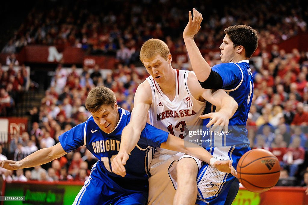 Grant Gibbs #10 of the Creighton Bluejays and Brandon Ubel #13 of the Nebraska Cornhuskers fight for a loose ball during their game at the Devaney Center on December 6, 2012 in Lincoln, Nebraska.