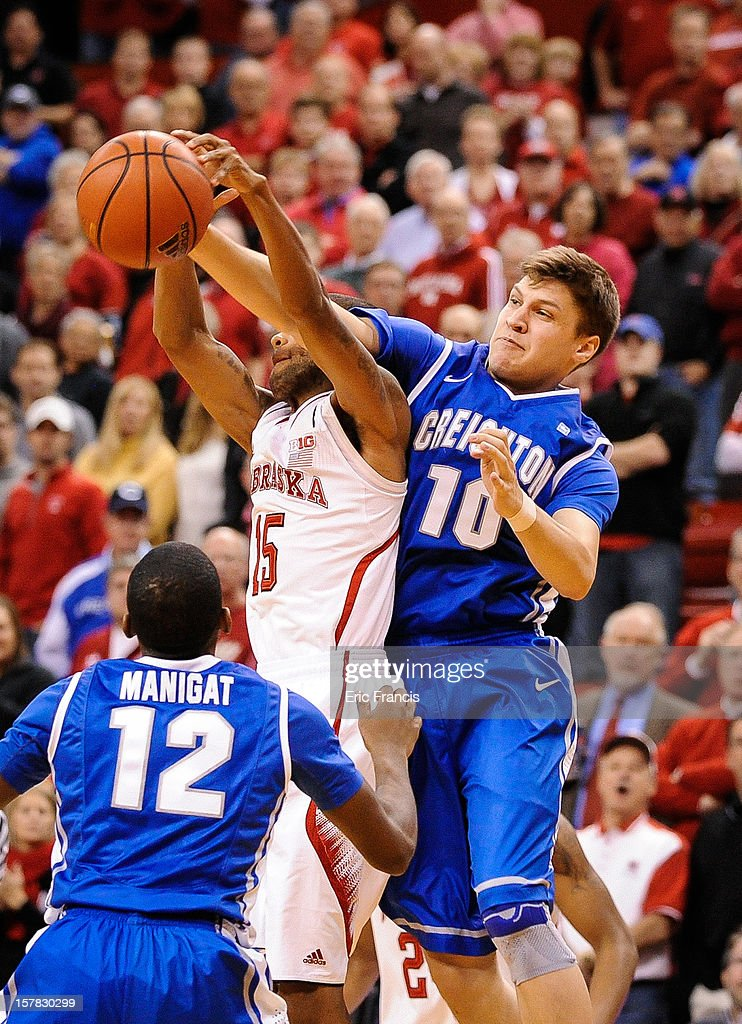 Grant Gibbs #10 of the Creighton Bluejays and Ray Gallegos #15 of the Nebraska Cornhuskers fight for a loose ball during their game at the Devaney Center on December 6, 2012 in Lincoln, Nebraska.