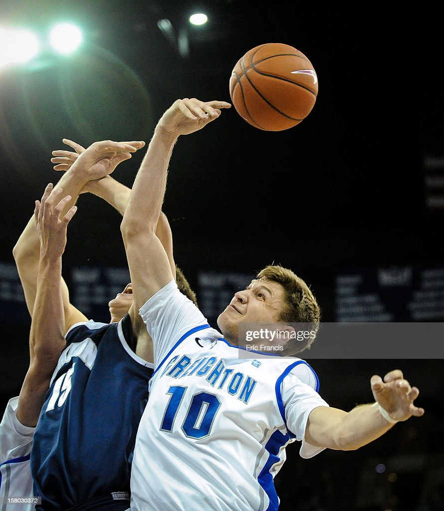 Grant Gibbs #10 of the Creighton Bluejays battles with Jake Kretzer #15 of the Akron Zips for a rebound during their game at the CenturyLink Center on December 9, 2012 in Omaha, Nebraska.