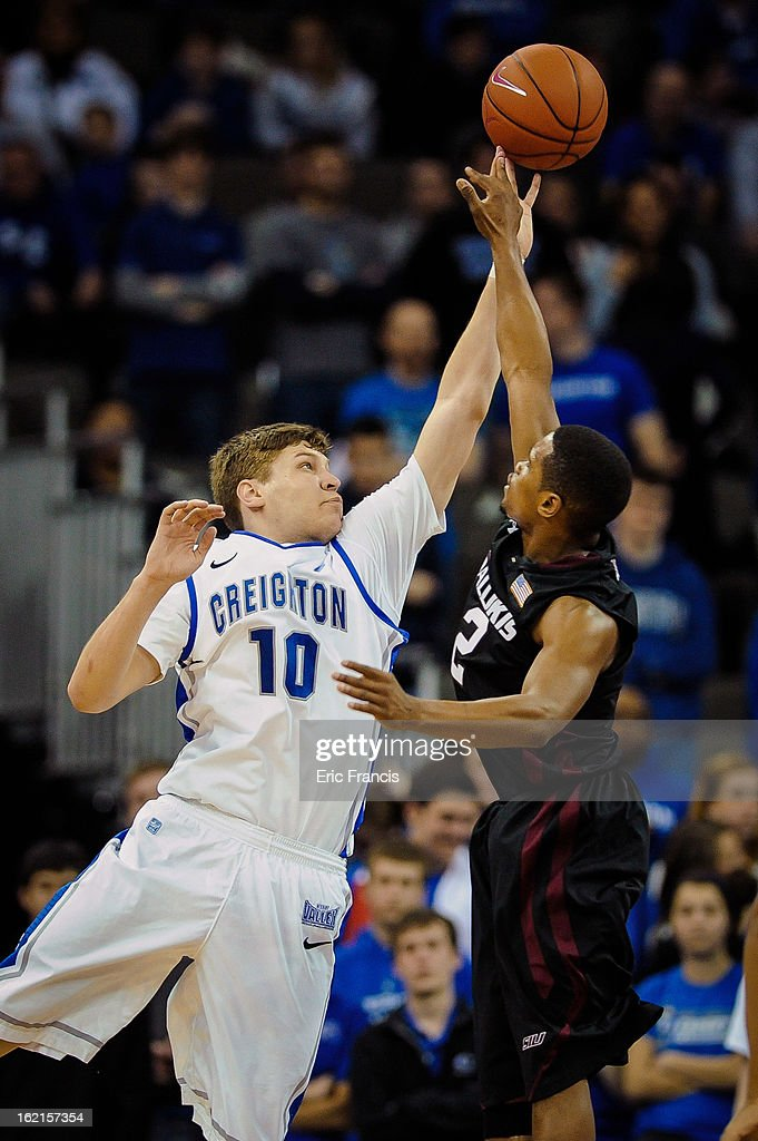 <a gi-track='captionPersonalityLinkClicked' href=/galleries/search?phrase=Grant+Gibbs&family=editorial&specificpeople=8833616 ng-click='$event.stopPropagation()'>Grant Gibbs</a> #10 of the Creighton Bluejays blocks the shot of Kendal Brown-Surles #2 of the Southern Illinois Salukis during their game at the CenturyLink Center on February 19, 2013 in Omaha, Nebraska.