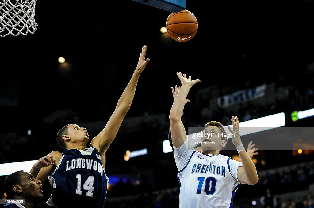Grant Gibbs #10 of the Creighton Bluejays floats a shot over the outstretched arm of Michael Kessens #14 of the Longwood Lancers during their game at CenturyLink Center on November 20, 2012 in Omaha, Nebraska.