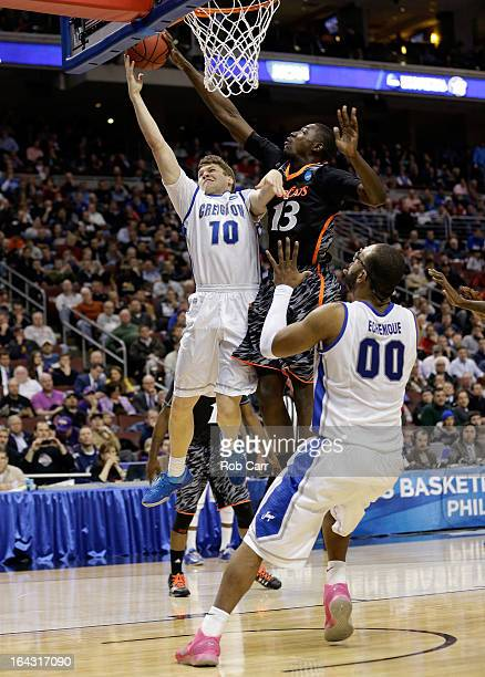 Grant Gibbs of the Creighton Bluejays goes up for a shot against Cheikh Mbodj of the Cincinnati Bearcats in the second half during the second round...
