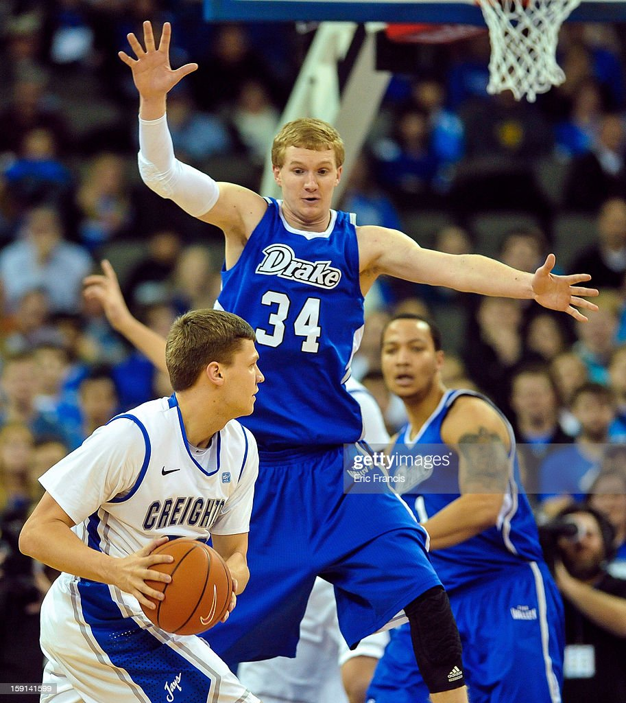 <a gi-track='captionPersonalityLinkClicked' href=/galleries/search?phrase=Grant+Gibbs&family=editorial&specificpeople=8833616 ng-click='$event.stopPropagation()'>Grant Gibbs</a> #10 of the Creighton Bluejays is guarded by Ben Simons #34 of the Drake Bulldogs during their game at the CenturyLink Center on January 8, 2013 in Omaha, Nebraska.