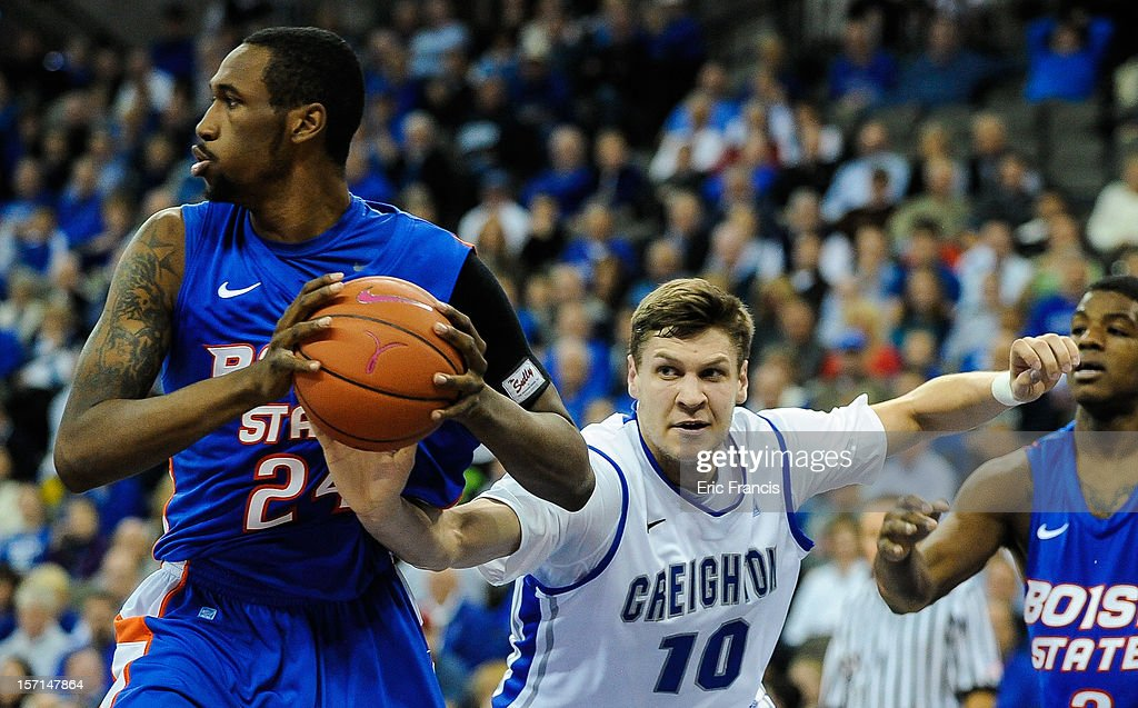 Grant Gibbs #10 of the Creighton Bluejays reaches in to knock the ball away from Darrious Hamilton #24 of the Boise State Broncos during their game at CenturyLink Center on November 28, 2012 in Omaha, Nebraska. Boise State beat Creighton 83-70.