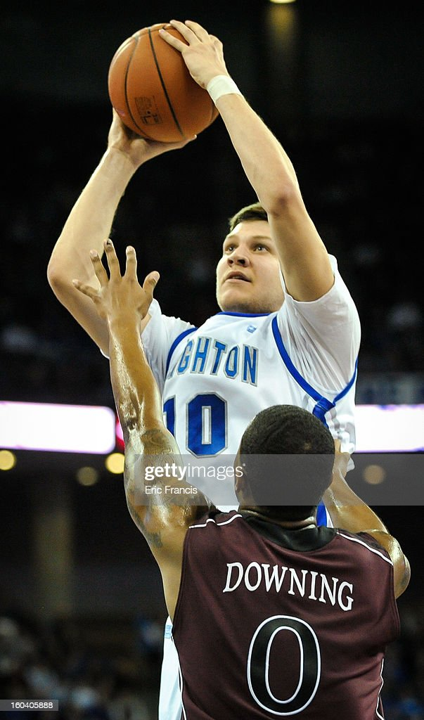 <a gi-track='captionPersonalityLinkClicked' href=/galleries/search?phrase=Grant+Gibbs&family=editorial&specificpeople=8833616 ng-click='$event.stopPropagation()'>Grant Gibbs</a> #10 of the Creighton Bluejays shoots over Anthony Downing #0 of the Missouri State Bears during their game at the CenturyLink Center on January 30, 2013 in Omaha, Nebraska. Creighton defeated Missouri State 91-77.