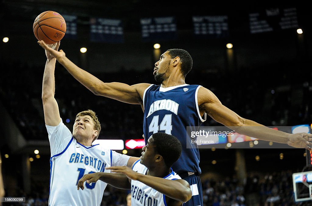 Grant Gibbs #10 of the Creighton Bluejays shoots over Zeke Marshall #44 of the Akron Zips during their game at the CenturyLink Center on December 9, 2012 in Omaha, Nebraska.