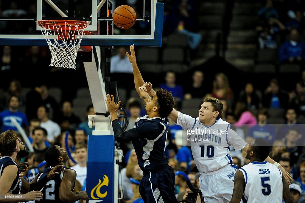 Grant Gibbs #10 of the Creighton Bluejays tries to affect the shot of Nik Brown #1 of the Longwood Lancers during their game at CenturyLink Center on November 20, 2012 in Omaha, Nebraska.