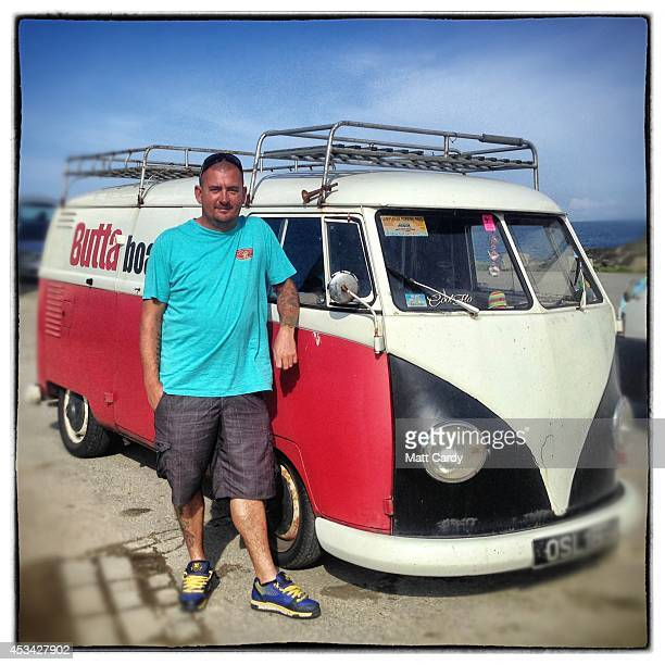 Grant Goree from Woking poses for a photograph besides his 1958 first generation or T1 splitscreen Volkswagen Transporter van in Newquay on August 6...
