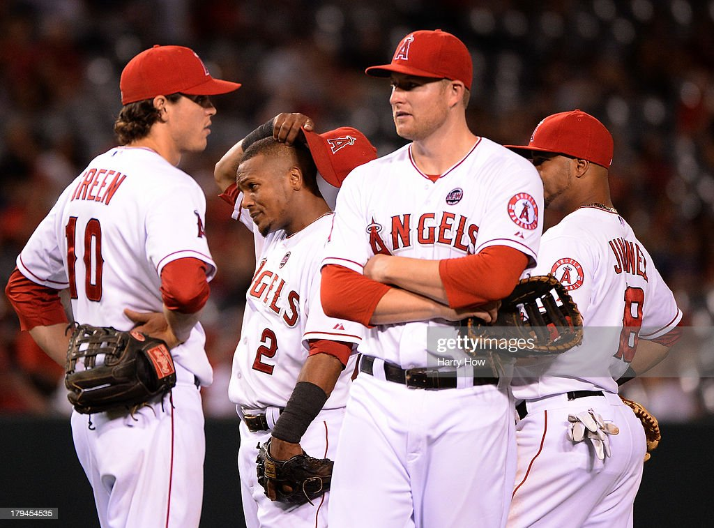 Grant Green #10, <a gi-track='captionPersonalityLinkClicked' href=/galleries/search?phrase=Erick+Aybar&family=editorial&specificpeople=551376 ng-click='$event.stopPropagation()'>Erick Aybar</a> #2, <a gi-track='captionPersonalityLinkClicked' href=/galleries/search?phrase=Mark+Trumbo&family=editorial&specificpeople=4921667 ng-click='$event.stopPropagation()'>Mark Trumbo</a> #44 and Luis Jimenez #18 of the Los Angeles Angels react during a pitching change to bring in Joe Blanton #55 to face the Tampa Bay Rays during the sixth inning at Angel Stadium of Anaheim on September 3, 2013 in Anaheim, California.