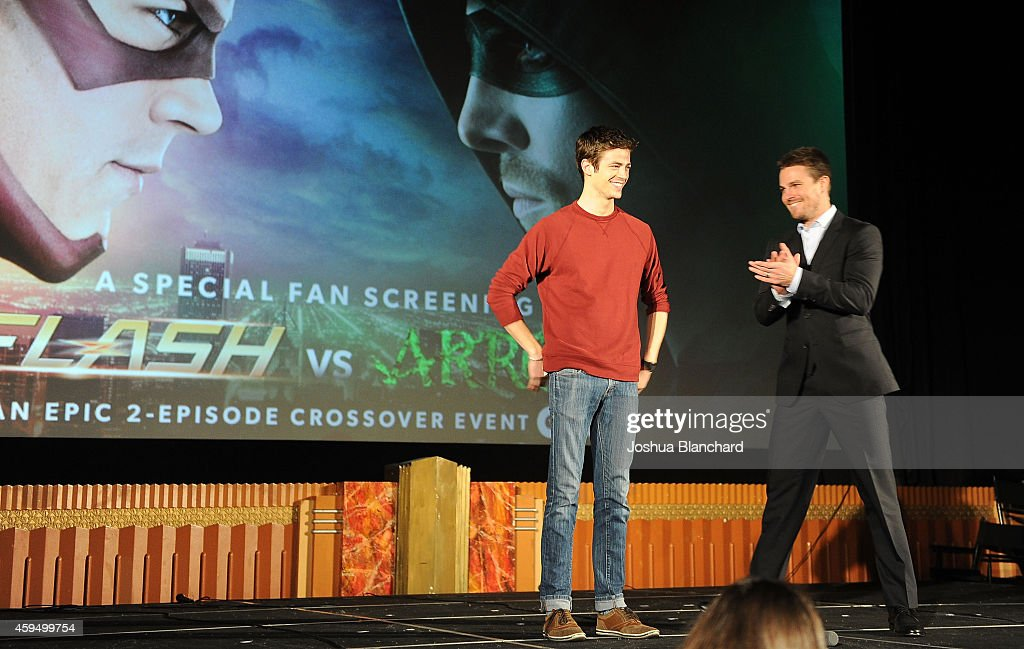 Grant Gustin (L) and Stephen Amell attend the special screening for the CW's 'Arrow' And 'The Flash' at Crest Theatre on November 22, 2014 in Westwood, California.
