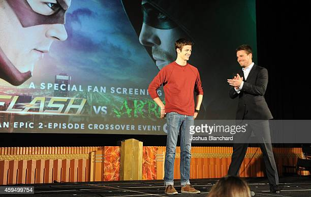 Grant Gustin and Stephen Amell attend the special screening for the CW's 'Arrow' And 'The Flash' at Crest Theatre on November 22 2014 in Westwood...