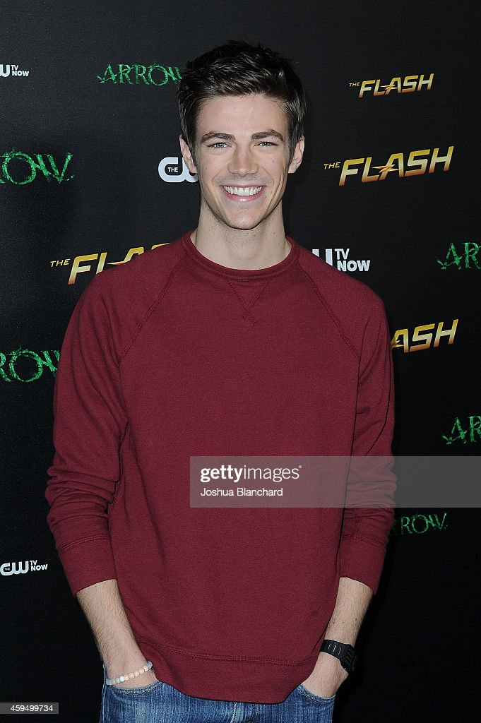 Grant Gustin arrives at a special screening for the CW's 'Arrow' And 'The Flash' at Crest Theatre on November 22, 2014 in Westwood, California.