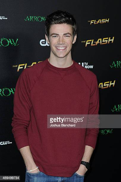 Grant Gustin arrives at a special screening for the CW's 'Arrow' And 'The Flash' at Crest Theatre on November 22 2014 in Westwood California