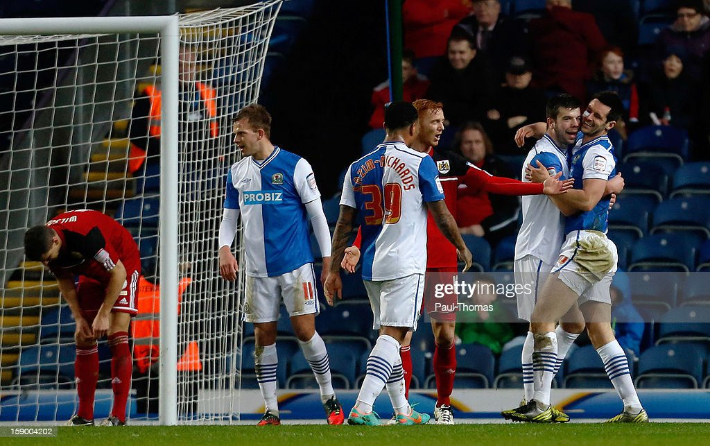 <a gi-track='captionPersonalityLinkClicked' href=/galleries/search?phrase=Grant+Hanley&family=editorial&specificpeople=6528826 ng-click='$event.stopPropagation()'>Grant Hanley</a> (2nd R) of Blackburn celebrates his goal with team mate <a gi-track='captionPersonalityLinkClicked' href=/galleries/search?phrase=Scott+Dann&family=editorial&specificpeople=4210129 ng-click='$event.stopPropagation()'>Scott Dann</a> (R) during the FA Cup with Budweiser Third Round match between Blackburn Rovers and Bristol City at Ewood Park on January 5, 2013 in Blackburn, England.