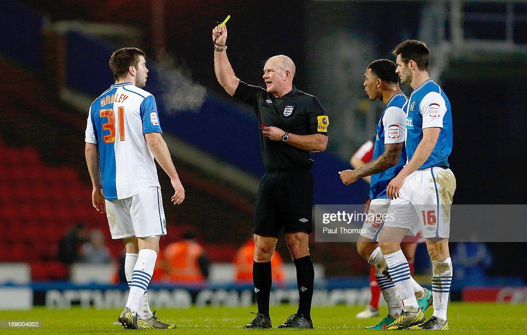 <a gi-track='captionPersonalityLinkClicked' href=/galleries/search?phrase=Grant+Hanley&family=editorial&specificpeople=6528826 ng-click='$event.stopPropagation()'>Grant Hanley</a> (L) of Blackburn receives a yellow card from referee Nigel Miller during the FA Cup with Budweiser Third Round match between Blackburn Rovers and Bristol City at Ewood Park on January 5, 2013 in Blackburn, England.