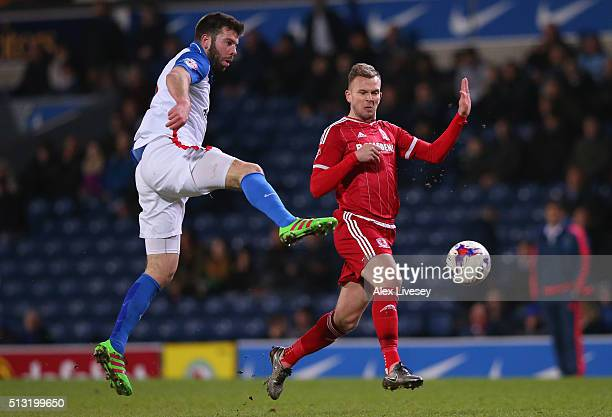 Grant Hanley of Blackburn Rovers and Jordan Rhodes of Middlesbrough compete for the ball during the Sky Bet Championship match between Blackburn...