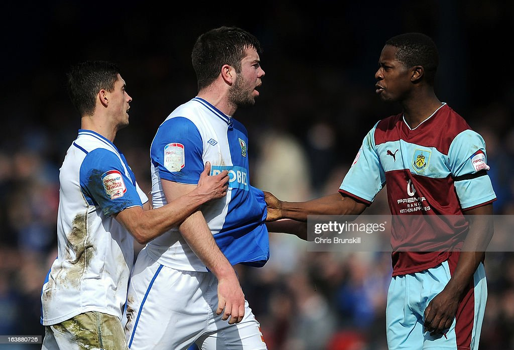 <a gi-track='captionPersonalityLinkClicked' href=/galleries/search?phrase=Grant+Hanley&family=editorial&specificpeople=6528826 ng-click='$event.stopPropagation()'>Grant Hanley</a> of Blackburn Rovers clashes with Marvin Bartley of Burnley during the npower Championship match between Blackburn Rovers and Burnley at Ewood park on March 17, 2013 in Blackburn, England.