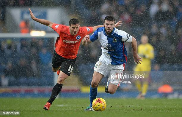 Grant Hanley of Blackburn Rovers gets past Tomer Hemed of Brighton and Hove Albion during the Sky Bet Championship match between Blackburn Rovers and...