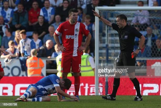 Grant Hanley of Blackburn Rovers is sent off by referee Mr Stuart Attwell during the Sky Bet Championship match between Wigan Athletic and Blackburn...