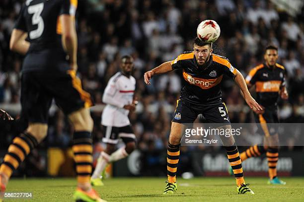 Grant Hanley of Newcastle United heads the ball during the Sky Bet Championship Match between Fulham and Newcastle United at Craven Cottage on August...