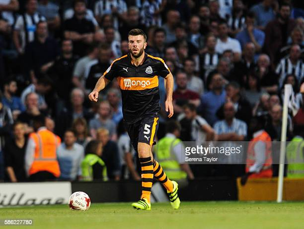 Grant Hanley of Newcastle United looks to pass the ball during the Sky Bet Championship Match between Fulham and Newcastle United at Craven Cottage...