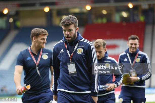 Grant Hanley of Scotland and team mates walk on the pitch prior to the FIFA 2018 World Cup Qualifier between Scotland and Malta at Hampden Park on...