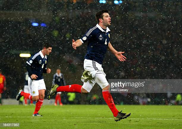 Grant Hanley of Scotland celebrates after scoring the opening goal during the FIFA 2014 World Cup Group A qualifying match between Scotland and Wales...