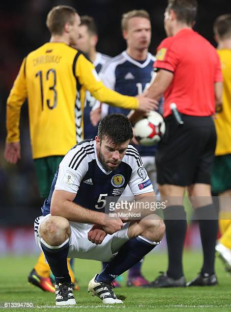 Grant Hanley of Scotland reacts at full time during the FIFA 2018 World Cup Qualifier between Scotland and Lithuania at Hampden Park on October 8...