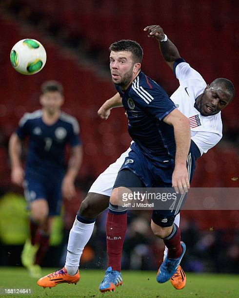 Grant Hanley of Scotland tackles Jozy Altidore of the USA during the international friendly at Hampden Park on November 15 2013 in Glasgow Scotland