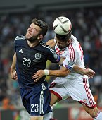 Grant Hanley of Scotland vies for a ball with Murtaz Daushvili of Georgia during their Euro 2016 qualifying football match between Georgia and...
