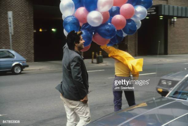 Grant Hart drummer and songwriter for the rock band Husker Du and friend play with balloons at the Minnesota Music Awards in Minneapolis Minnesota on...
