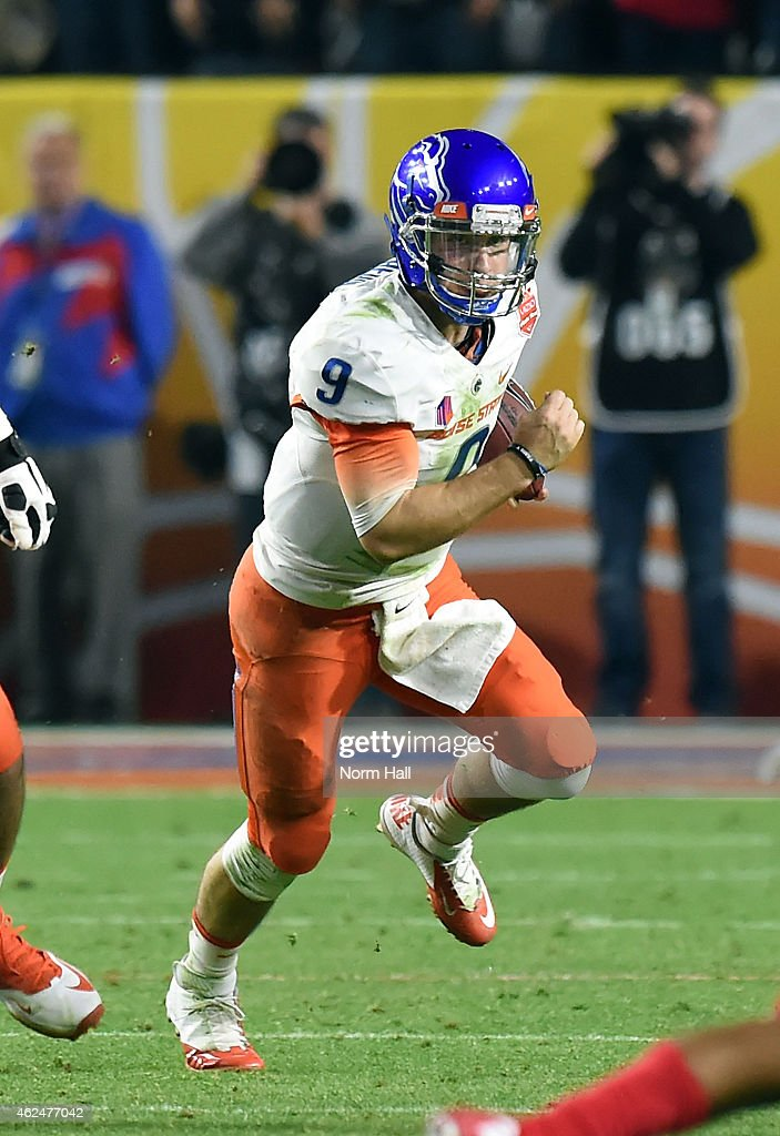 <a gi-track='captionPersonalityLinkClicked' href=/galleries/search?phrase=Grant+Hedrick&family=editorial&specificpeople=7159943 ng-click='$event.stopPropagation()'>Grant Hedrick</a> #9 of the Boise State Broncos runs with the ball against the Arizona Wildcats at University of Phoenix Stadium on December 31, 2014 in Glendale, Arizona.