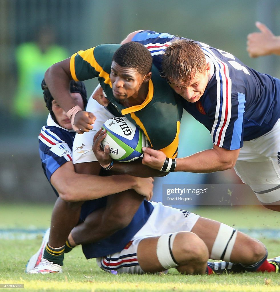 Grant Hermanus of South Africa is tackled during the World Rugby U20 Championship 3rd Place Play-Off match between France and South Africa at Stadio Giovanni Zini on June 20, 2015 in Cremona, Italy.