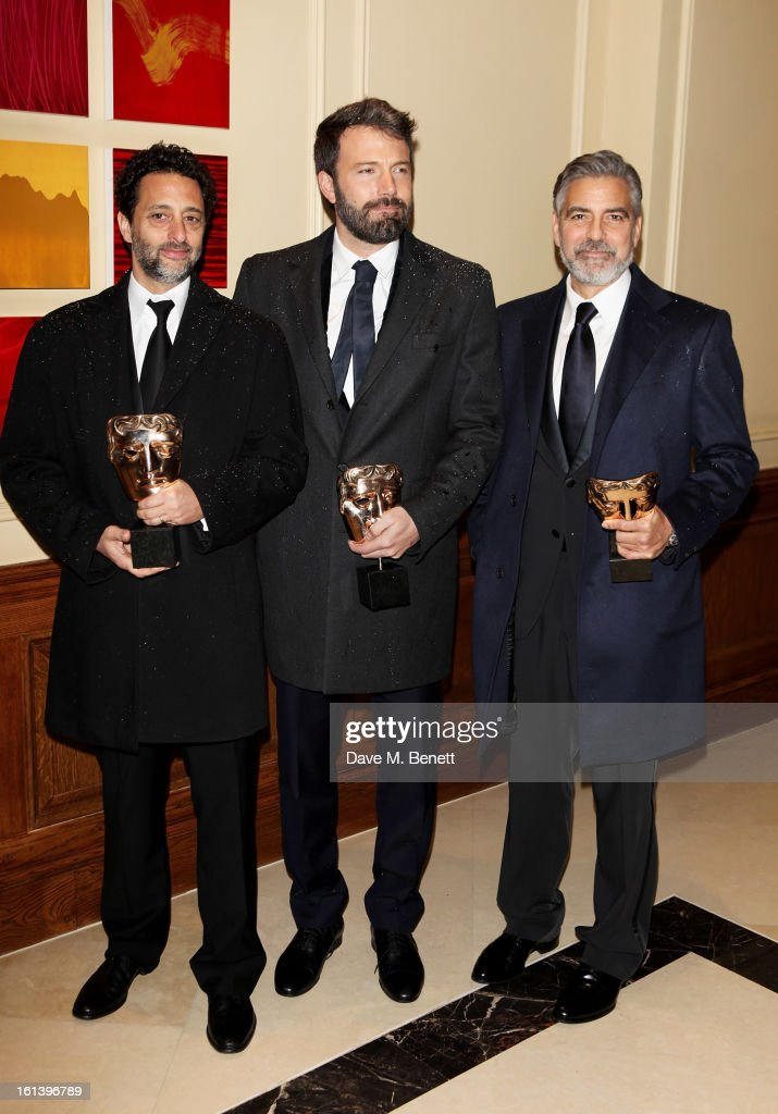 Grant Heslov Ben Affleck and George Clooney arrive at the after party following the EE British Academy Film Awards at Grosvenor House on February 10...