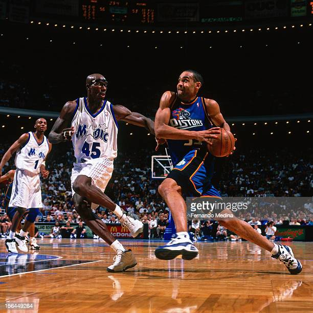 Grant Hill of the Detroit Pistons dribbles against Bo Outlaw of the Orlando Magic during a game circa 1999 at the Orlando Arena in Orlando Florida...