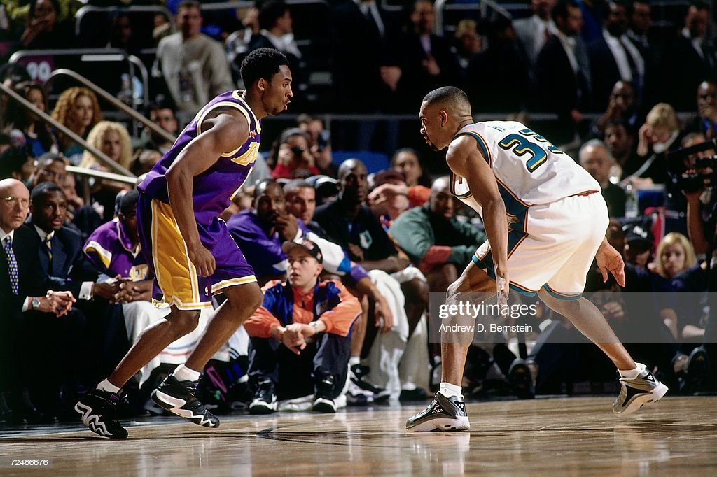 Grant Hill of the Eastern Conference AllStars digs in on defense against Kobe Bryant of the Western Conference AllStars during the 1998 NBA AllStar...
