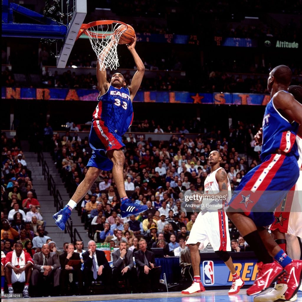 Grant Hill # 33 of the Eastern Conference All-Stars dunks against the Western Conference All-Stars during the 2005 All-Star Game on February 20, 2005 at The Pepsi Center in Denver, Colorado.
