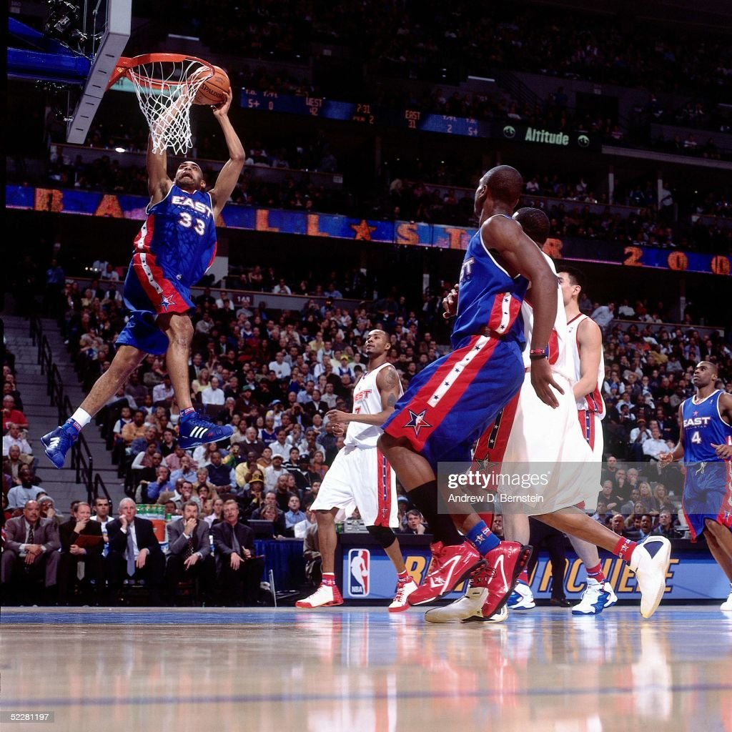 Grant Hill #33 of the Eastern Conference All-Stars dunks against the Western Conference All-Stars during the 2005 All-Star Game on February 20, 2005 at The Pepsi Center in Denver, Colorado.