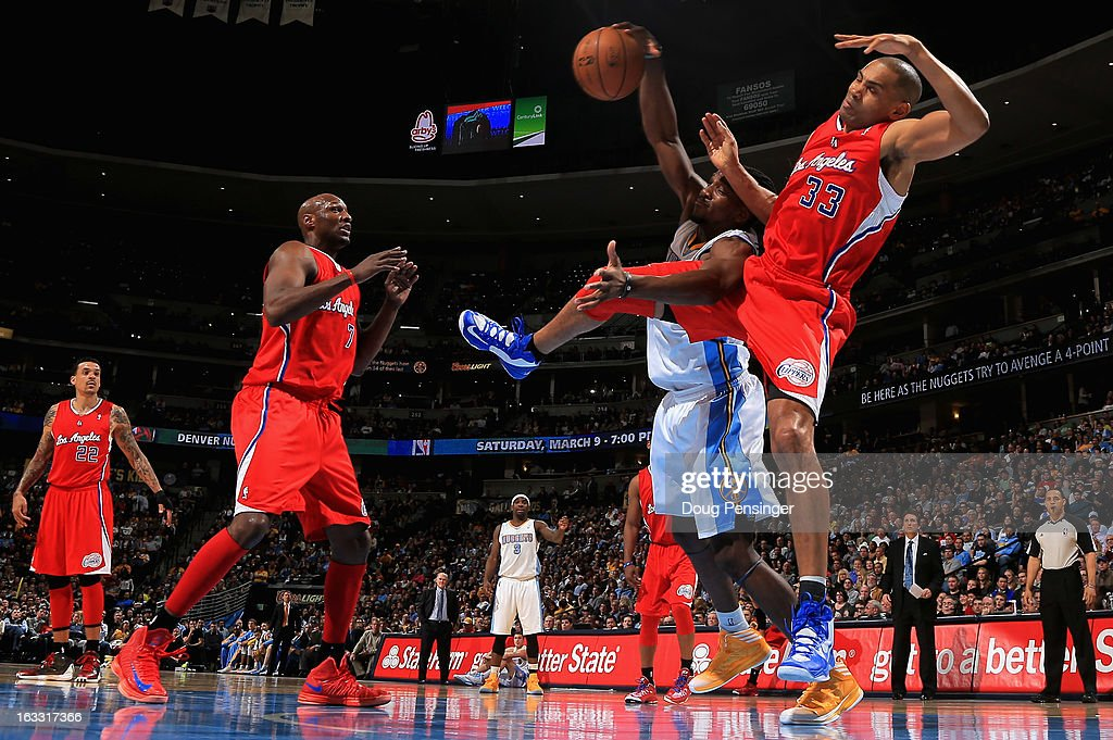 Grant Hill #33 of the Los Angeles Clippers and Kenneth Faried #35 of the Denver Nuggets collide as they vie for a rebound as Lamar Odom #7 of the Los Angeles Clippers watches the play at the Pepsi Center on March 7, 2013 in Denver, Colorado. The Nuggets defeated the Clippers 107-92.